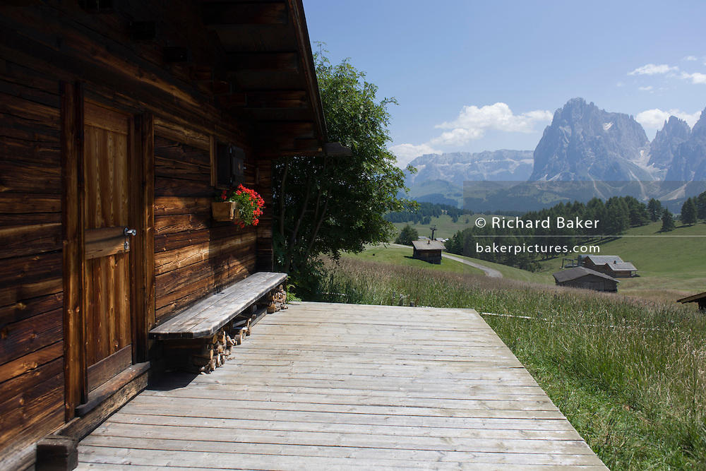 Panoramic views from alpine hut on the Siusi plateau, above the South Tyrolean town of Ortisei-Sankt Ulrich in the Dolomites, Italy.