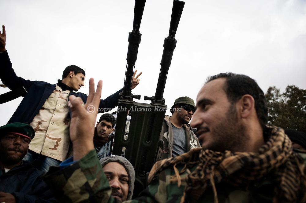 Anti government fighters celebrate close by a anti-aircraft gun in benghazi, Libya..ALESSIO ROMENZI