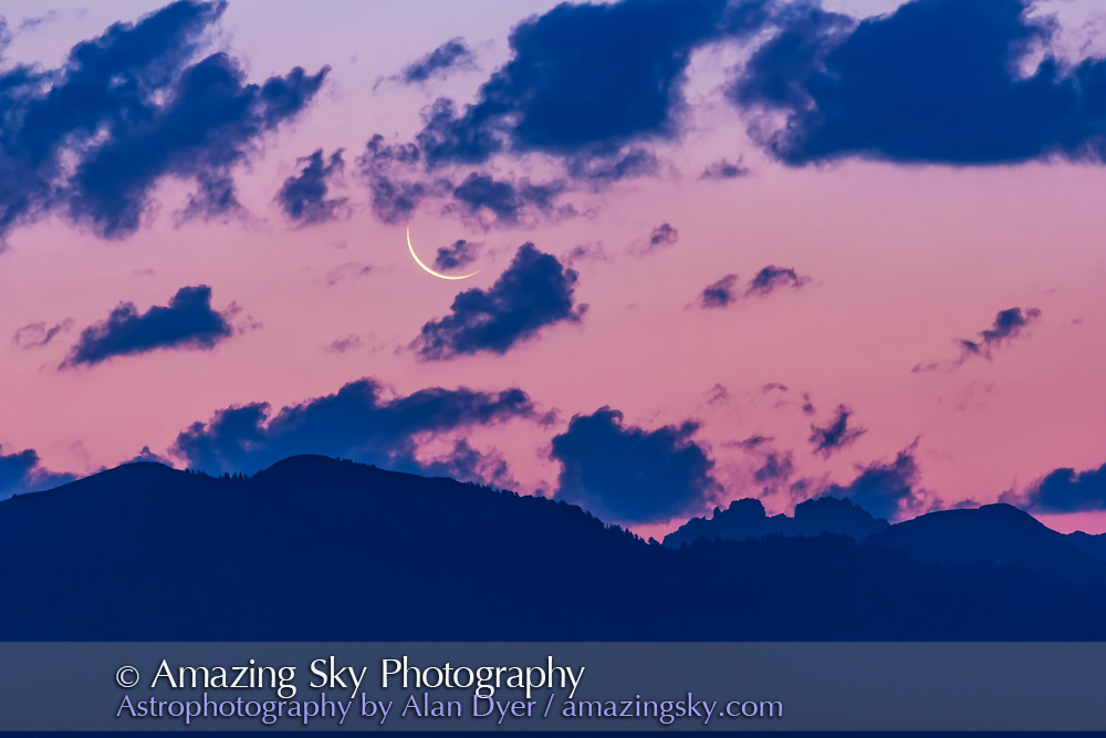 The thin waning crescent Moon at dawn on August 20, 2017, on the last morning it could be sighted before the total eclipse on August 21. The Moon has risen over the foothills and peaks of the Grand Tetons in Wyoming, though this view is from the Idaho side looking northeast. <br /> <br /> Taken with the Canon 60Da and 200mm lens.