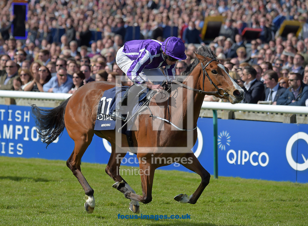 Minding with Ryan Moore (purple with white stripe sleeves and purple cap) wins Qipco 1000 Guineas Stakes during the QIPCO Guineas Festival  on the  Newmarket Rowley Mile Course, Newmarket, UK.<br /> Picture by Martin Lynch/Focus Images Ltd 07501333150<br /> 01/05/2016