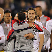 Landon Donovan, USA, ris congratulated by team mates after his farewell match during the USA Vs Ecuador International match at Rentschler Field, Hartford, Connecticut. USA. 10th October 2014. Photo Tim Clayton