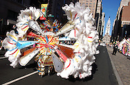 PHILADELPHIA - JANUARY 1:  A member of the Oregon Fancy Club marches up Broad Street during the 103rd New Year's Day Mummer's Parade January 1, 2004 in Philadelphia, Pennsylvania. The day long parade features four divisions which are Comics, Fancy Clubs, Fancy Brigades, and String Bands. The clubs develop a theme, create costumes, build sets and props, and coreograph musical and dance numbers while competing for $386,000 in prizes. (Photo by William Thomas Cain/Getty Images).