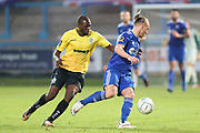 FC Halifax Town midfielder Matty Kosylo (7) shields the ball during the Vanarama National League match between FC Halifax Town and Dover Athletic at the Shay, Halifax, United Kingdom on 17 November 2018.