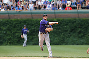 CHICAGO, IL - JUNE 27: Troy Tulowitzki #2 of the Colorado Rockies throws after fielding a ground ball against the Chicago Cubs at Wrigley Field on June 27, 2011 in Chicago, Illinois. The Cubs won 7-3. (Photo by Joe Robbins) *** Local Caption *** Troy Tulowitzki