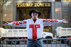 © Licensed to London News Pictures. 08/11/2016. New York CIty, USA. A Pro-Donald Trump and Republican supporter campaigns outside Trump Tower in New York City on Tuesday, 8 November, the day of the presidential election in the United States of America. Photo credit: Tolga Akmen/LNP
