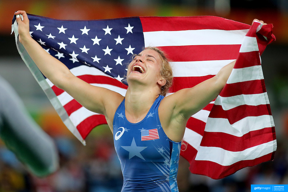 Wrestling - Olympics: Day 13   Helen Louise Maroulis of the United States celebrates with the United States flag after winning the Gold Medal against Saori Yoshida of Japan in the Women's Freestyle 53 kg Final match at the Carioca Arena 2 on August 18, 2016 in Rio de Janeiro, Brazil. (Photo by Tim Clayton/Corbis via Getty Images)