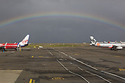 Rainbow appears over both Jetstar and Virgin Blue tail wings