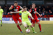 Crawley Town Defender Jon Ashton (16) stops Hartlepool United midfielder Nathan Thomas (7) from getting past him during the Sky Bet League 2 match between Crawley Town and Hartlepool United at the Checkatrade.com Stadium, Crawley, England on 19 March 2016. Photo by Andy Walter.