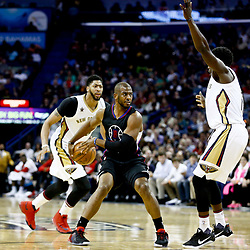 Dec 28, 2016; New Orleans, LA, USA;  Los Angeles Clippers guard Chris Paul (3) passes behind his back as New Orleans Pelicans guard Jrue Holiday (11) and forward Anthony Davis (23) defend during the second quarter of a game at the Smoothie King Center. Mandatory Credit: Derick E. Hingle-USA TODAY Sports