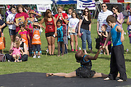 Newburgh, New York - Dancers from the Art in Motion Dance Academy perform for a crowd during the Relay for Life of Newburgh at Cronomer Hill Park on June 8, 2013. The Relay for Life is the American Cancer Society's signature fundraising event. Participants celebrate the lives of people who have battled cancer, remember loved ones lost, and fight back against the disease by raising money.