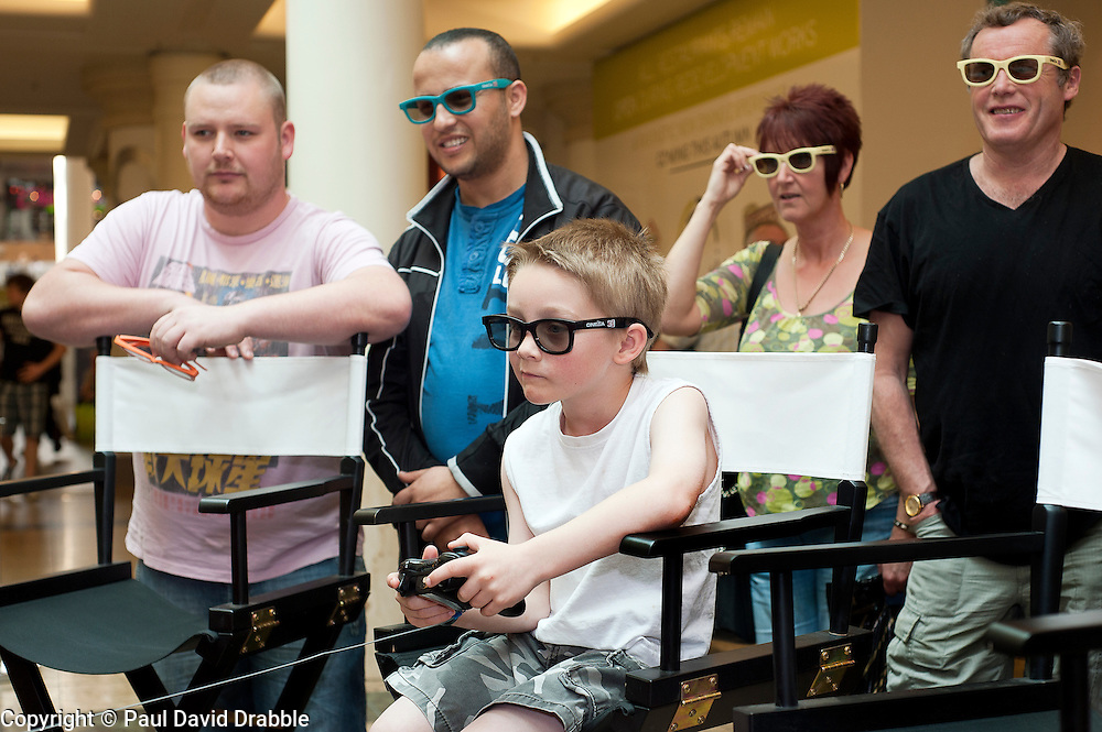 Kai Higgins (aged 6) tries his had at 3D gaming in LG's Life's Good Lounge interactive living room installation which was in Meadowhall over the bank holiday ..22 April 2011.Images © Paul David Drabble