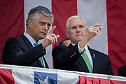 Vice President Mike Pence, right, and Savannah Mayor Eddie DeLoach, left, watch the St. Patrick's Day parade from the balcony at City Hall, Saturday, March 17, 2018, in Savannah, Ga. (AP Photo/Stephen B. Morton)