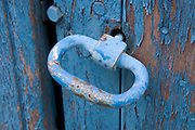 old metal handle in a weathered wooden door