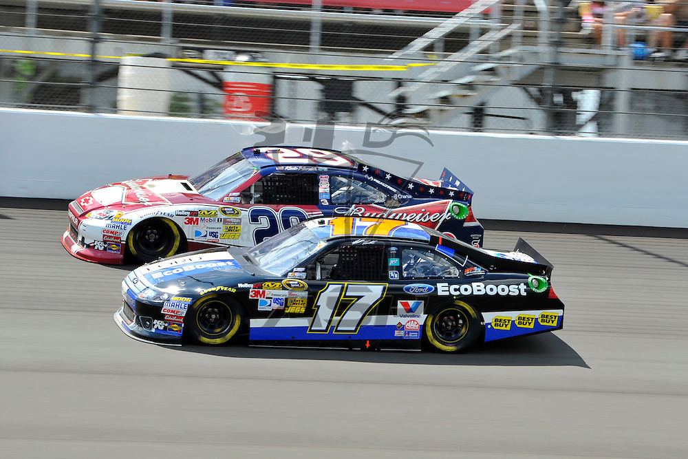 Brooklyn, MI - JUN 17, 2012: Matt Kenseth (17) and Kevin Harvick (29) race during race action for the Quicken Loans 400 race at the Michigan International Speedway in Brooklyn, MI.