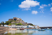 Mount Orgueil Castle overlooking the harbour and bay at Gorey on the east coast of Jersey, Channel Isles
