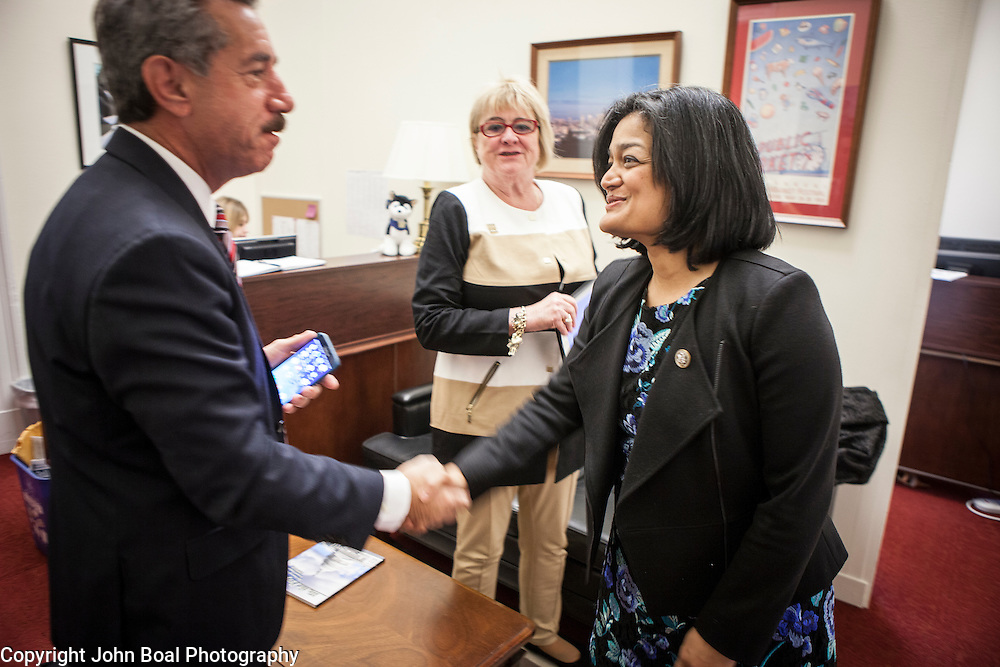 Representative Pramila Jayapal (D-WA, 7) greets James Pishue, President and CEO, and Gloria Stewart of the Washington Bankers Association, on Tuesday, January 31, 2017.  John Boal photo/for The Stranger