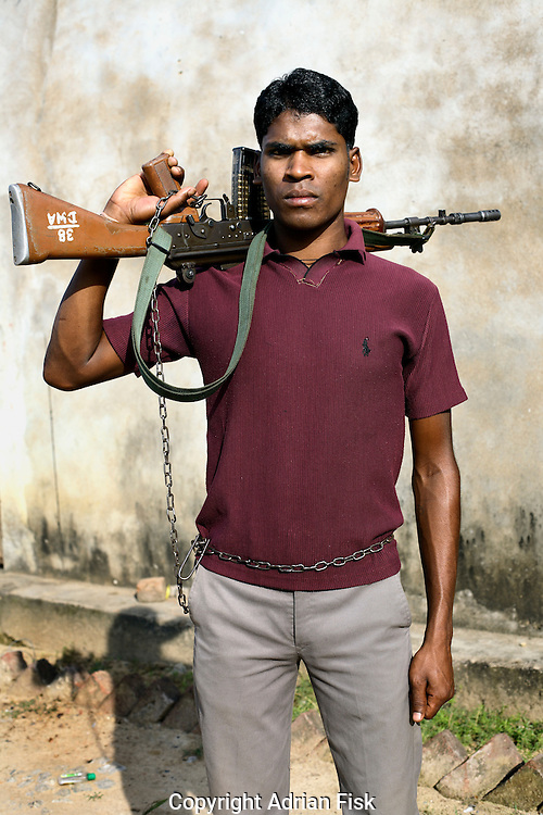 A Salwa Judam Special Police Officer (SPO) stands within the confines of a protected police compound with his INSAS rifle. Weapons are chained to the SPO militia making it much harder for the Naxalites to take them..SPO's are paid Rs1250 (18 Euro) a month and have no ranking system or opportunity to rise within the ranks.