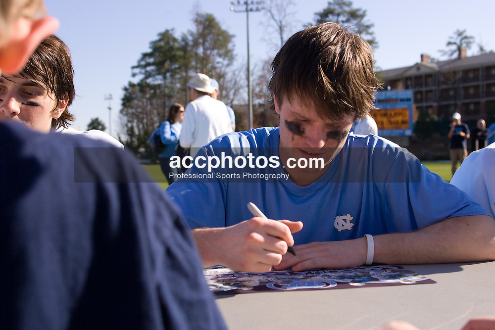 02 March 2008: North Carolina Tar Heels attackman Michael B. Burns (29) (Garden City, NY) signs autographs for fans after a 13-8 win over the Cornell Big Red on Fetzer Field in Chapel Hill, NC.