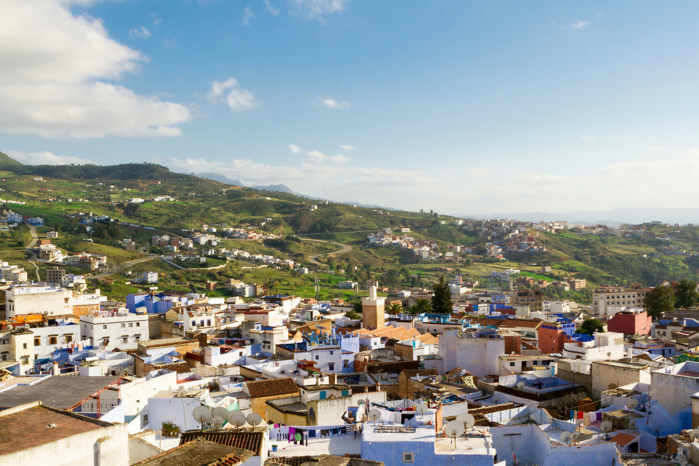 View of the Chefchaouen Medina - the blue city- amid Rif Mountain landscape setting, Rif region of Northern Morocco, 2014-03-27.