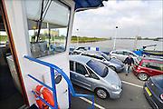 Nederland, Pannerden, 8-4-2015 Het veer en de veerman over het Pannerdensch kanaal.Foto: Flip Franssen/Hollandse Hoogte