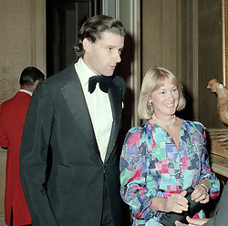 NICHOLAS PHILLIPS (d.1991) and his wife MARIA of Luton Hoo at a reception in Bedfordshire in September 1985.