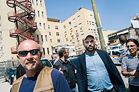 """NAPLES, ITALY - 30 JULY 2018: Roberto Saviano (2nd from right), an Italian journalist, writer and essayist is seen here with his police escort by the hospital Santa Maria di Loreto in Naples, Italy, on July 30th 2018.<br /> <br /> In 2015 the 19-year-old fugitive and gang leader Emanuele Sibillo was shot and brought to the Santa Maria di Loreto hospital by two gang fellows. He died shortly after arriving at the hospital.<br /> <br /> After the first death threats of 2006 by the Casalese clan , a cartel of the Camorra, which he denounced in his exposé and in the piazza of Casal di Principe during a demonstration in defense of legality, Roberto Saviano was put under a strict security protocol. Since 2006 Roberto Saviano has lived under police protection.<br /> <br /> Saviano's latest novel """"The Piranhas"""", which tells the story of the rise of  a paranza (or Children's gang) and it leader Nicolas, will be released in the United States on September 4th 2018."""