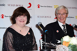 Susan Boyle press conference. <br /> In the frame - Host: Paul O'Grady with<br /> Scottish singer Boyle, who found fame after appearing on Britain's Got Talent, attends press conference where she announces new single O Come, All Ye Faithful, a duet with Elvis Presley, at Sony Music Entertainment, London, United Kingdom. Monday, 28th October 2013. Picture by Nils Jorgensen / i-Images