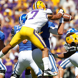 October 1, 2011; Baton Rouge, LA, USA;  LSU Tigers cornerback Tyrann Mathieu (7) strips the ball from Kentucky Wildcats quarterback Maxwell Smith (11) during the third quarter at Tiger Stadium. LSU defeated Kentucky 35-7. Mandatory Credit: Derick E. Hingle-US PRESSWIRE / © Derick E. Hingle 2011