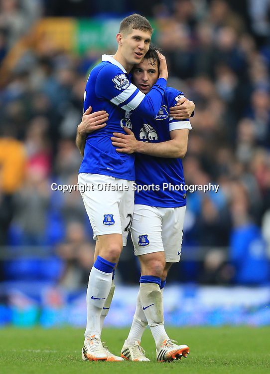 20th April 2014 - Barclays Premier League - Everton v Manchester United - John Stones of Everton (L) celebrates with teammate Leighton Baines - Photo: Simon Stacpoole / Offside.