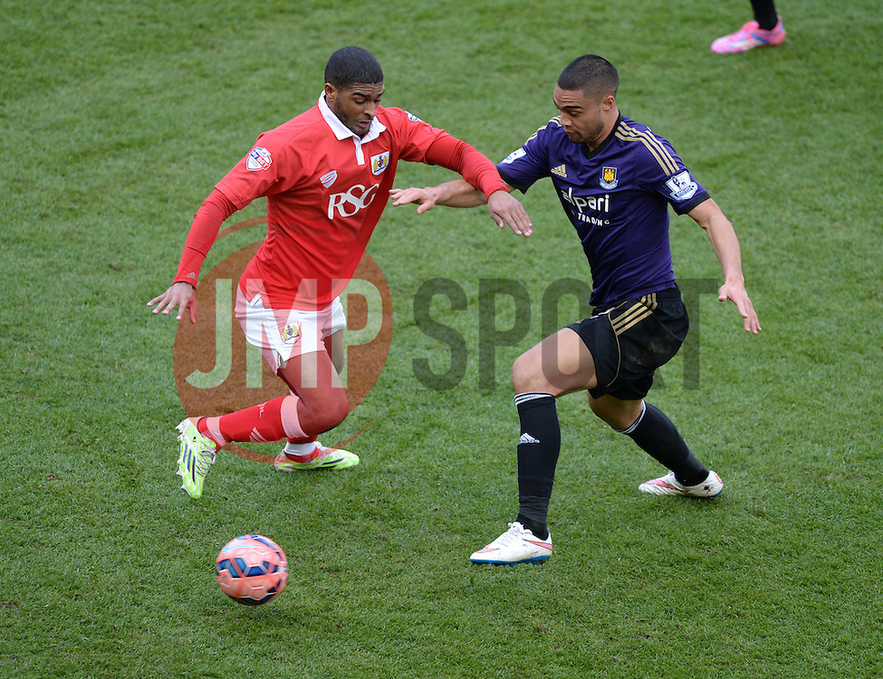 Bristol City's Derrick Williams battles for the ball with West Ham's Winston Reid - Photo mandatory by-line: Alex James/JMP - Mobile: 07966 386802 - 25/01/2015 - SPORT - Football - Bristol - Ashton Gate - Bristol City v West Ham United - FA Cup Fourth Round