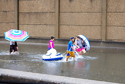 (170828) -- HOUSTON, Aug. 28, 2017 (Xinhua) -- People walk in water in Houston, Texas, the United States, Aug. 27, 2017. Widespread and worsening flood conditions prompted the closure of nearly every major road in Houston as the outer bands of Hurricane Harvey swept through the Houston area over the weekend. Latest news reports said the storm death toll has climbed to at least 5. (Xinhua/Zhong Jia) (zjl)  (Photo by Xinhua/Sipa USA)