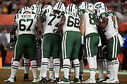 The New York Jets offense huddles and calls a play from its own end zone during the 2018 NFL regular season week 3 football game against the Cleveland Browns on Thursday, Sept. 20, 2018 in Cleveland. The Browns won the game 21-17. (©Paul Anthony Spinelli)