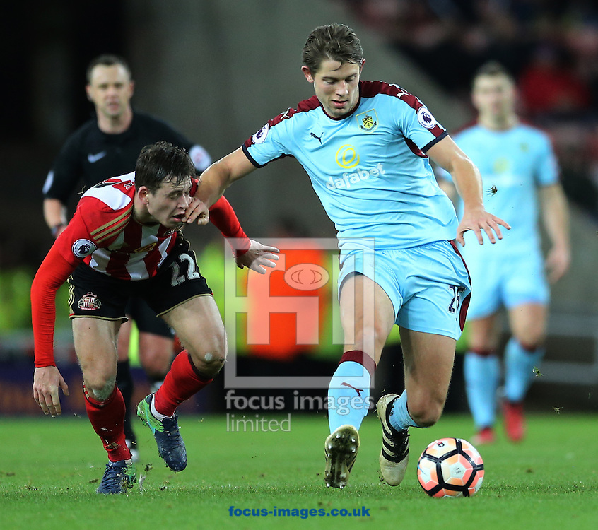 Donald Love (l) of Sunderland is held off by James Tarkowski of Burnley during the third round of the FA Cup at the Stadium Of Light, Sunderland<br /> Picture by Simon Moore/Focus Images Ltd 07807 671782<br /> 07/01/2017