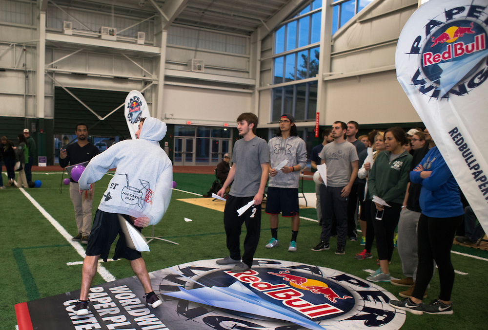 Simon Moskowitz, a freshman studying Exercise Physiology attempts to throw his paper air plane backwards at the Red Bull Paper Wings Qualifier held at Ohio University. © Ohio University / Photo by Olivia Wallace