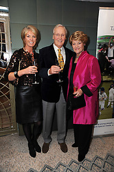 Left to right, NIKKI NICHOLLS and her mother & step father NICHOLAS & ANNIE PARSONS at the Lady Taverners Tribute Lunch in honour of Nicholas Parsons held at The Dorchester, Park Lane, London on 20th November 2009.