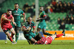 Leicester Tigers centre, Seremaia Bai is tackled by Scarlets fly half, Rhys Priestland - Photo mandatory by-line: Dougie Allward/JMP - Mobile: 07966 386802 - 16/01/2015 - SPORT - Rugby - Leicester - Welford Road - Leicester Tigers v Scarlets - European Rugby Champions Cup