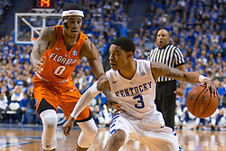 Kentucky guard Tyler Ulis, right, looks for an open teammate with pressure from Florida guard Kasey Hill in the first half.<br /> <br /> The University of Kentucky hosted the University of Florida, Saturday, Feb. 06, 2016 at Rupp Arena in Lexington .