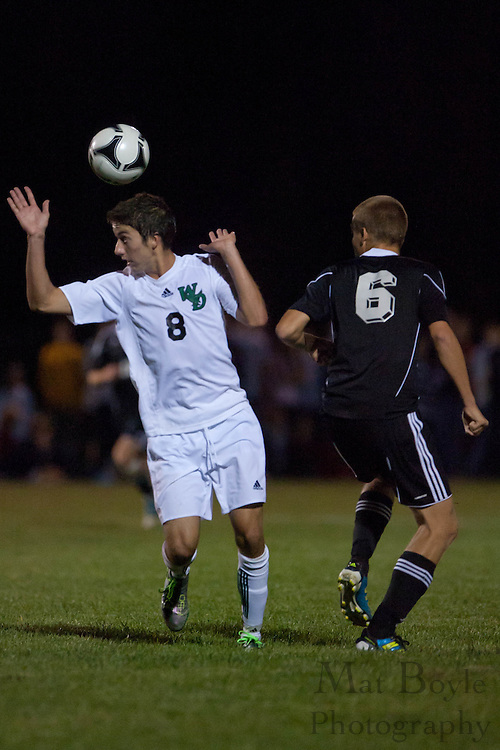 West Deptford's Kyle Redrow and a Haddonfield player both miss a head-ball during a home game on Monday September 19, 2011.