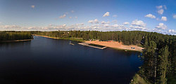 Lake Verevi in Elva, Estonia. Beach, forest. Wooden platform, boardwalk.
