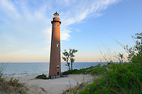 A glow appears on Little Point Sable Lighthouse as the sun rises up over the dunes.  <br /> Little Point Sable Lighthouse ~ Mears, Michigan