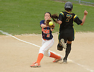 Middletown, NY - The Orange County Community College first baseman reaches for the ball as a Mercer County Community College runner crosses first base during the National Junior College Athletic Association District G women's softball championship game at Fancher Davidge Park on May 5, 2007..