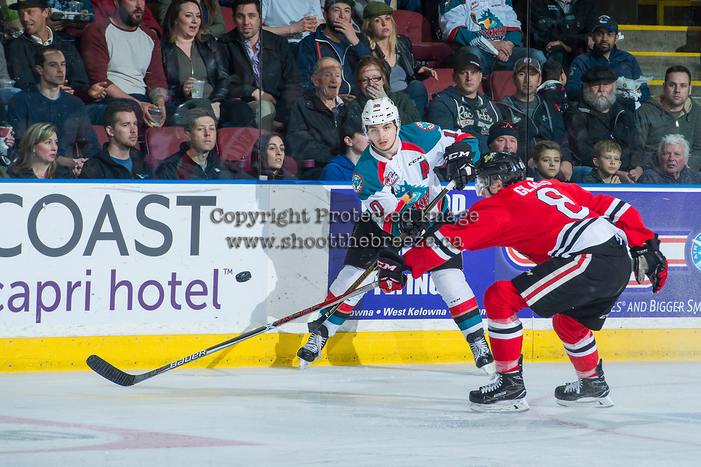 KELOWNA, CANADA - APRIL 14: Nick Merkley #10 of the Kelowna Rockets passes the puck as Cody Glass #8 of the Portland Winterhawks attempts to block with his stick on April 14, 2017 at Prospera Place in Kelowna, British Columbia, Canada.  (Photo by Marissa Baecker/Shoot the Breeze)  *** Local Caption ***
