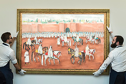 "© Licensed to London News Pictures. 29/03/2019. LONDON, UK. Technicians present ""La Sortie du Roi"", 2007, by Hassan El Glaoui (Est. GBP 80,000-120,000). Preview of Sotheby's upcoming Modern and Contemporary African Art sale.  Works from artists across the African diaspora will be offered for sale on 2 April.  Photo credit: Stephen Chung/LNP"