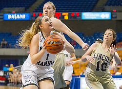 North Marion guard Presley Tuttle (1) shoots under the basket against Lincoln during a first round game at the Charleston Civic Center.