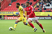 AFC Wimbledon striker Andy Barcham (17) dribbling away from Charlton Athletic midfielder Jake Forster-Caskey (19) during the EFL Sky Bet League 1 match between Charlton Athletic and AFC Wimbledon at The Valley, London, England on 28 October 2017. Photo by Matthew Redman.