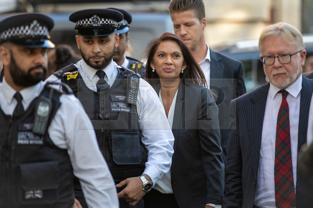 © Licensed to London News Pictures. 19/09/2019. London, UK. Gina Miller (centre) arrives at the Supreme Court in London flanked by police for the third day of the hearing into the legality of the prorogation of Parliament. The case has been brought by remain campaigner Gina Miller, with support from former British Prime Minister John Major. Photo credit: Rob Pinney/LNP