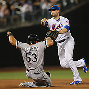 NEW YORK, NEW YORK - May 31:  Neil Walker #20 of the New York Mets turns a double play as Melky Cabrera #53 of the Chicago White Sox slides into second during the Chicago White Sox  Vs New York Mets regular season MLB game at Citi Field on May 31, 2016 in New York City. (Photo by Tim Clayton/Corbis via Getty Images)