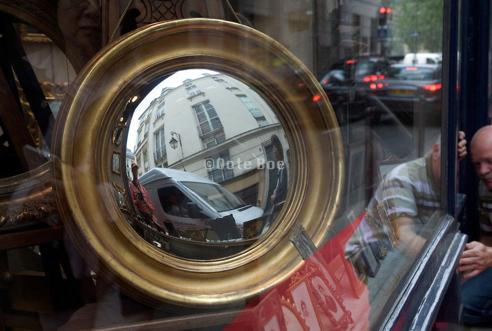 window display at an antique store in Paris St. Germain des Pres Rue des Saints Peres