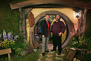 British actor Martin Freeman and New Zealand Director Peter Jackson pose for photographs on a 'Hobbiton' set in a claridges suite in west London, Monday, Dec. 1, 2014. (Photo by Joel Ryan/Invision/AP)