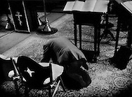 Church member prostrates during a ceremony in the sanctuary of the Russian Orthodox Church in Hakodate, Hokkaido, Japan.